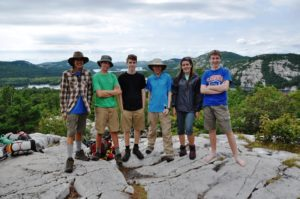 "Jared, Philip, Ian, Daniel, Lucy and James enjoy the awe-inspiring views from the top of ""The Crack."""