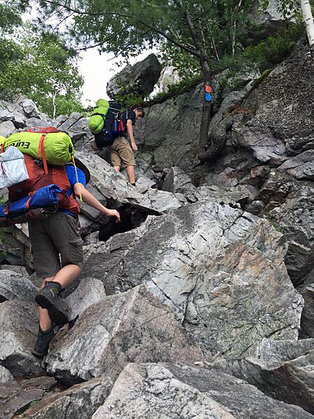 "Ian and James conquer ""The Crack"" by clambering over boulders the size of small cars."